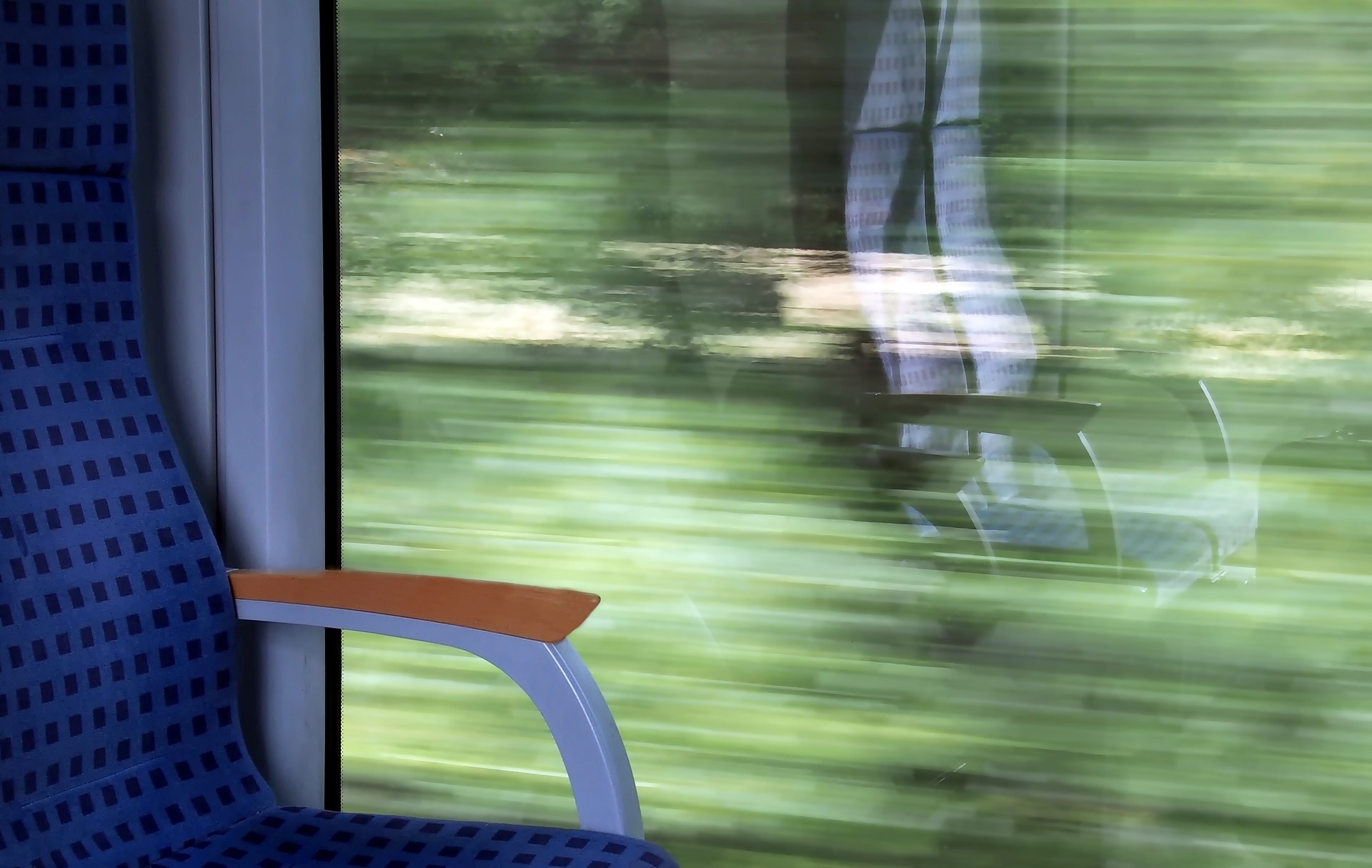 photo of train with blurry window as train is in motion